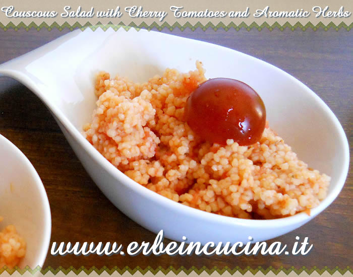 Couscous salad with cherry tomatoes and aromatic herbss